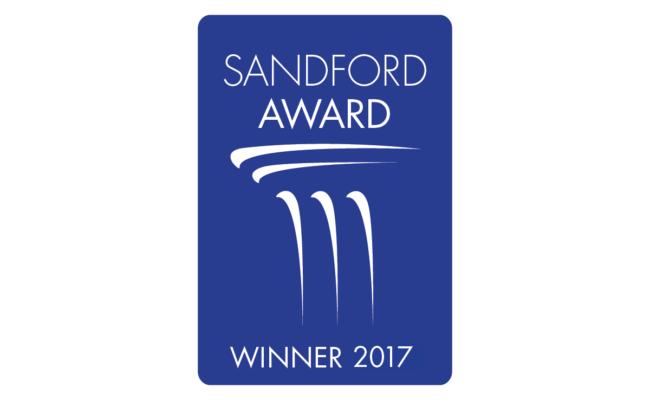 "Blue logo with white writing saying ""Sandford Award Winner 2017"""