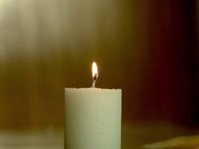 White candle with flame