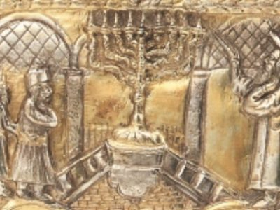 Detail of bottom of Lamp which shows a man lighting a Hanukah Lamp