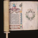 Megillah partially closed on its scroll, ivory handle, one column of Hebrew text and a crest to show beginning