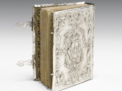 Prayer book with silver binding and outer.