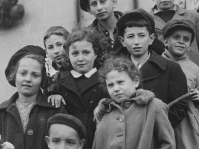 B & w photo of children in coats