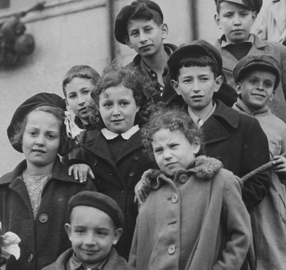 B & w photo of children in coats