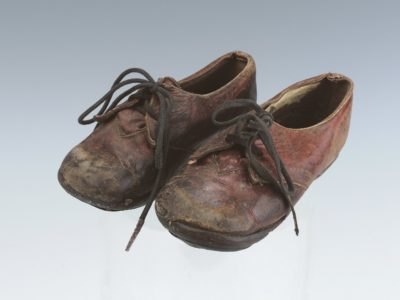well worn pair of brown shoes