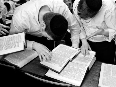 B & w photo of boys studying Jewish texts