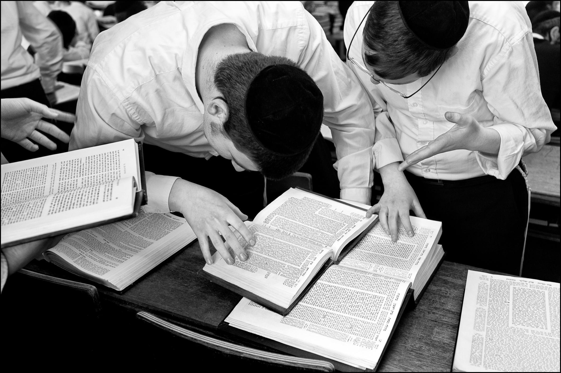 B & w photo of boys studying Jewish texts