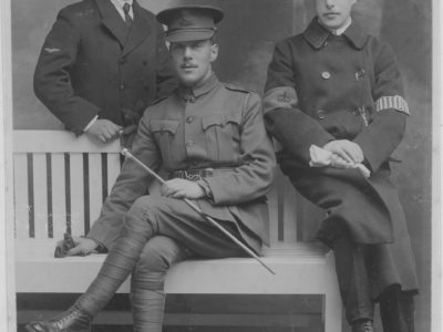 Black and white photo of three men in army uniforms.