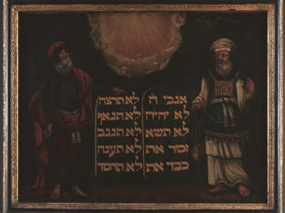 An oil painting showing a tablet flanked by Moses and Aaron.