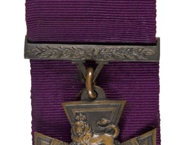A star shaped medal with a lion at the centre.