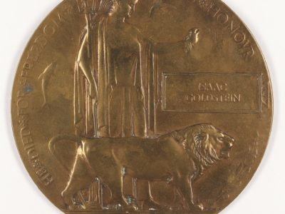 A bronze circular medal with a lion and Britannia on the front.