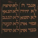 Up close painting of the tablet with the Ten Commandments painted in gold