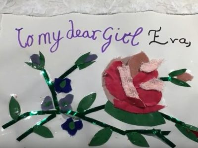 """Craft of a green and red rose under a caption sayinf """"To my dear girl Eva"""""""