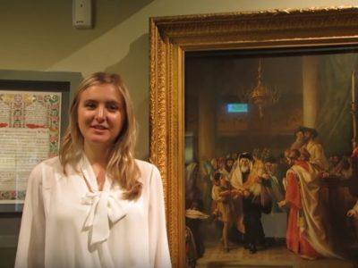 Intern stood next to painting