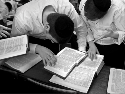 Black and white photo of boys studying the Talmud