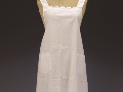 Photo of a manikin with a white apron on it
