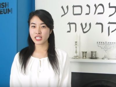 Intern stood in front of Hebrew lettering.