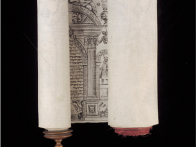 Image of a Megillah scroll, wrapped aorund a wooden pole with decorations in black ink.