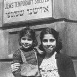 Girls outside temporary shelter