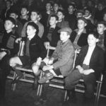 Group of boys enjoying a film in their hostel in Windermere, where they were housed shortly after their arrival in England.