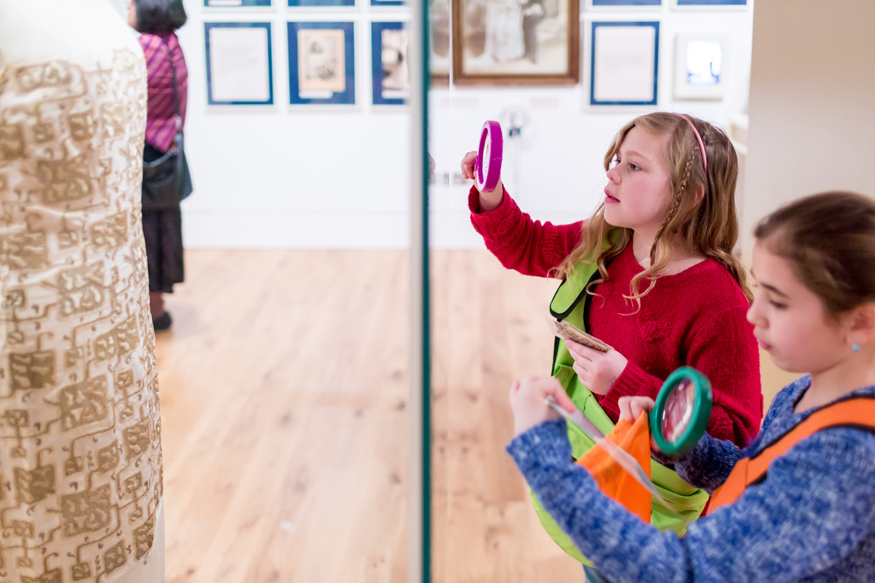 Two children looking at an exhibit