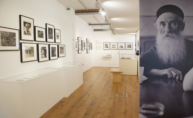 Photography exhibition with black and white photos on the walls