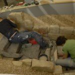Two people working in the Jewish Museum's medieval Mikveh - installing it in the newly refurbished museum