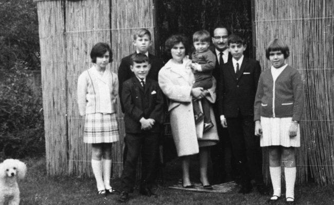 photograph of family outside sukkah