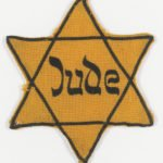 Yellow star badge of the Meninger family: Yellow star badge worn by Jews under Nazi rule, from the Meninger family of Vienna.