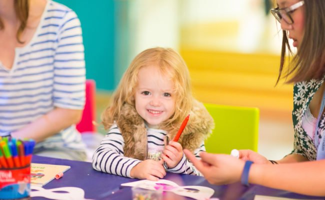 Young child enjoying craft activity at family day at the Jewish Museum London