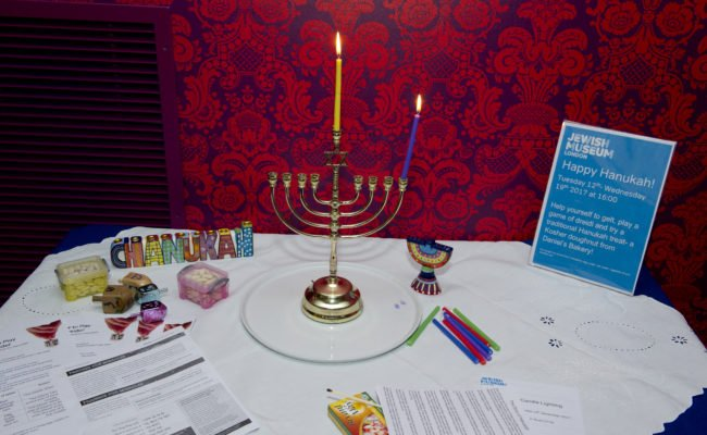 Table with Hanukah candle holder and crafts