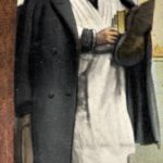 Close up of card with father in white robe and black coat