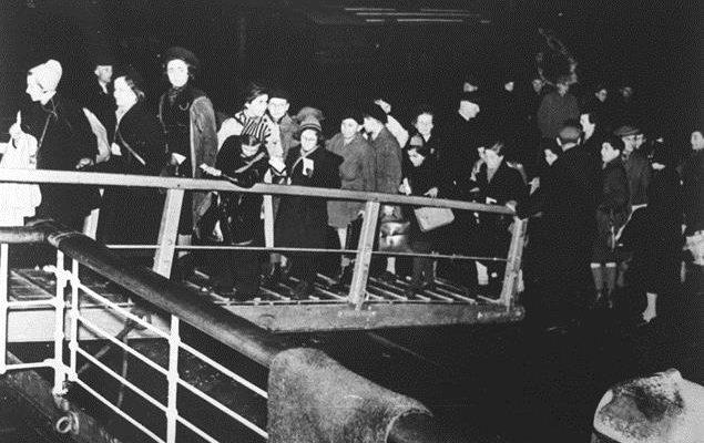 black and white photo of children boarding train
