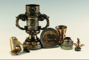 A selection of ritual containers such as goblets and pots, metal and engraved