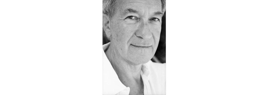 Portrait of older gentleman in white shirt smiling. Simon Schama - Image credit Margherita Mirabella
