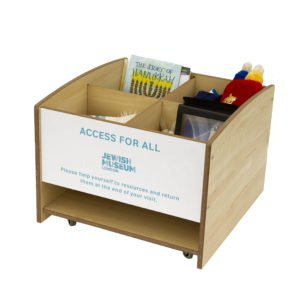 Wooded box trolley with resources inside. Resources include book and Teddy Torah