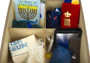 Resources including a book, teddy torah and magnifier