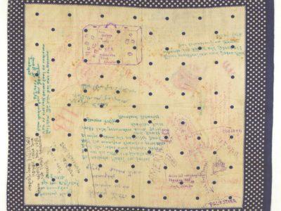 A polka dot handkerchief with hand-written messages