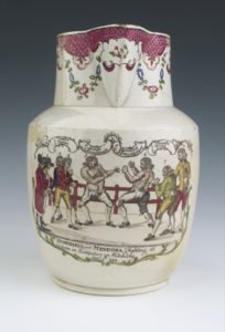 A white jug with drawings on it