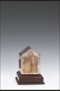 A gold box with a pointed roof