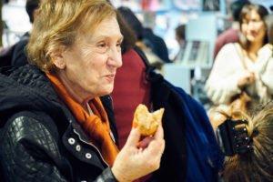 A woman eating a doughnut
