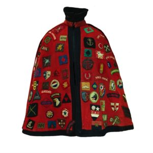 A red cape with badges on it