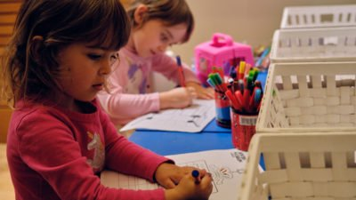Two children colouring
